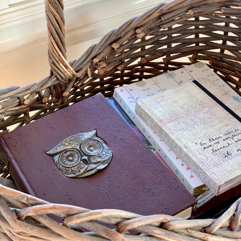journals in a basket