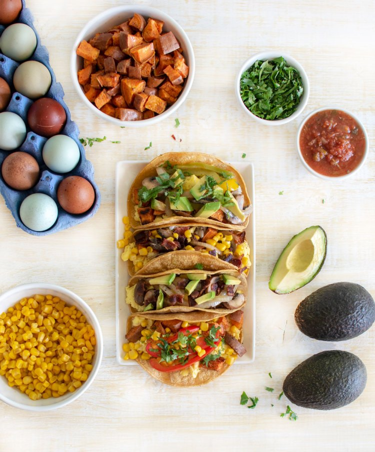 Breakfast taco recipe that uses leftovers from your fridge! My easy recipe for Mammoth Breakfast Tacos is perfect for using up leftovers from the holidays. These breakfast tacos can be made any way you like by simply changing up the combination of ingredients #tacos #breakfasttacos #leftovers #leftoverideas #leftoverrecipes #organictacos