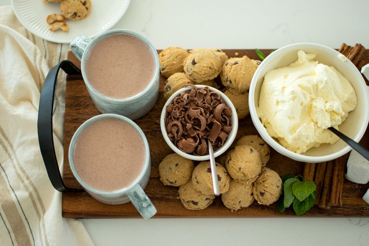 How to make a Hot Chocolate Charcuterie Board. This easy recipe for creating your own Hot Chocolate Charcuterie Board is perfect for any winter celebration. Make homemade whipped cream and easy 4 ingredient hot chocolate to go with some sweets and snacks for a cozy night inside #hotchocolate #charcuterieboard #organic #organicmilk #organiccookies #organicdessert #hotchocolatecharcuterieboard #familydessert