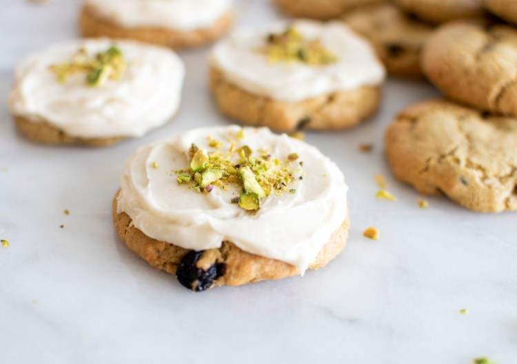 Easy and delicious soft and chewy Blueberry Pistachio Cookies. Soft and chewy blueberry cookies topped with a sweet pistachio icing for the best cookie recipe! High altitude cookie recipe, soft and chewy cookie recipe, the best soft and chewy blueberry cookie recipe. Easy blueberry cookies, soft and chewy blueberry cookies, simple blueberry cookies. Cookies with the best icing. #cookies #blueberries #blueberrycookies #pistachiocookies #pistachio #highaltitudecookies #highaltitudebaking