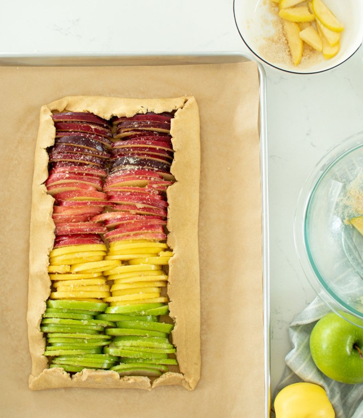 Easy Rainbow Apple Galette, the perfect alternative to pie this Thanksgiving! This galette is a freeform pie that uses different apples for different flavors for each slice #galette #pie #apple #applepie #apples #highaltitudebaking #thanksgiving