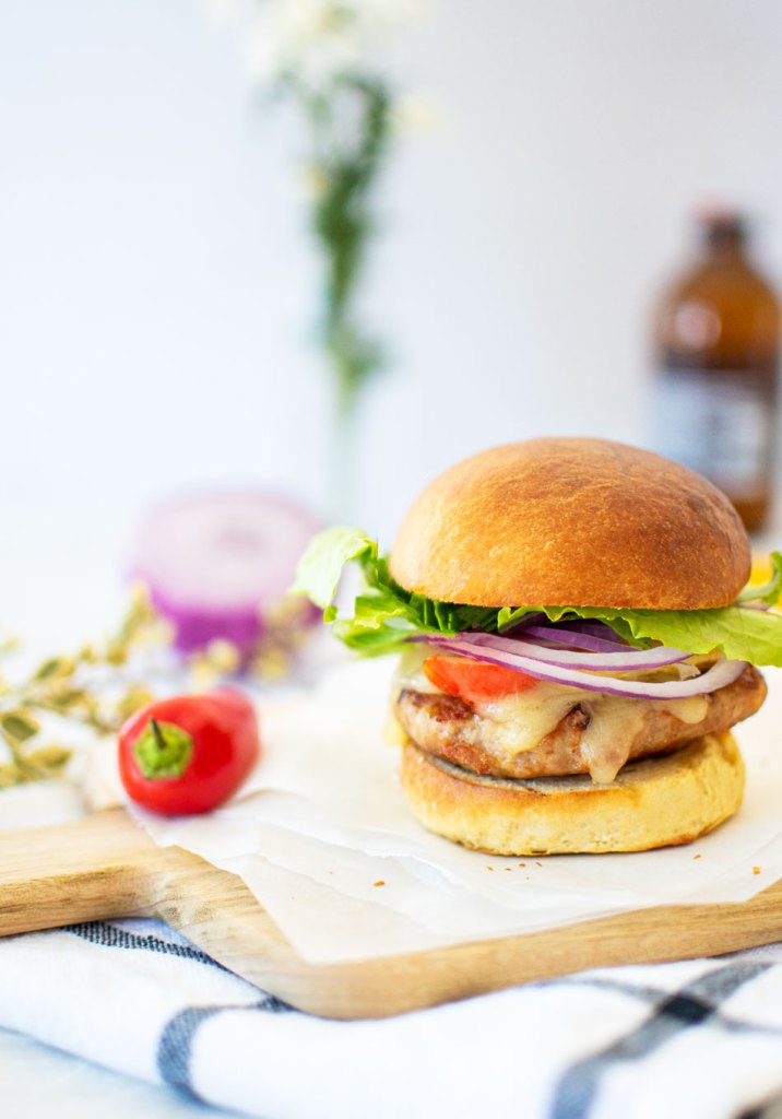 Easy and flavorful Grilled Turkey Burger recipe with homemade Brioche Buns. The best grilled turkey burger recipe! Moist and flavorful turkey burgers with grilled peppers, mozzarella, red onion, and lettuce. Make your own homemade hamburger buns to take these turkey burgers to the next level! Organic grilled turkey burger recipe. Easy and delicious grilled turkey burger recipe. Homemade turkey burger recipe. Healthy turkey burger recipe. Healthy and organic turkey burger recipe. #organicburger #turkeyburger #homemadeburger #organicdinner #dinnerrecipe #grilledburgers #healthyburgers
