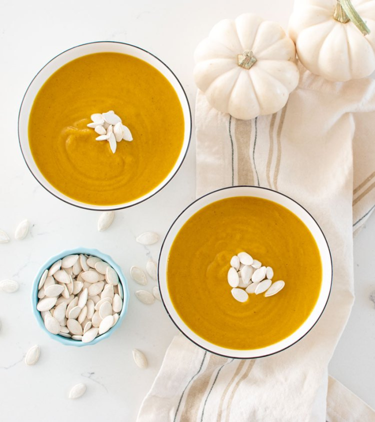 Healthy and creamy Vegan Roasted Cauliflower Pumpkin Soup. Easy and delicious dairy free soup recipe. This healthy soup is full of vegetables and makes a great meal or side dish #organic #soup #vegan #vegansoup #dairyfree #egglessrecipe #egglessoup #dairyfreesoup #creamysoup #healthysoup