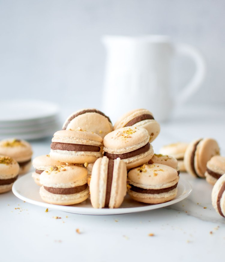 How to make pistachio french macarons. The best pistachio french macaron recipe. This easy chocolate pistachio french macaron recipe is naturally gluten free. High altitude chocolate pistachio french macaron recipe. Chocolate macaron filling recipe. #frenchmacarons #highaltitude #pistachio #chocolatepistachio #frenchmacarons