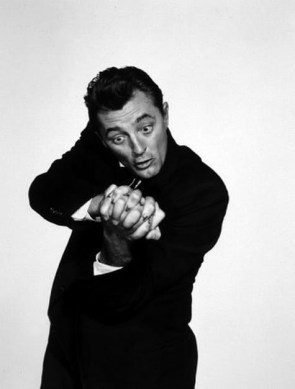 Robert Mitchum struggles with man's dual nature in this publicity still for the United Artists release, The Night of the Hunter (1955)