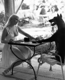 MADONNA playing backgammon against a dog in a Versace ad photographed by Steven Meisel in 1995