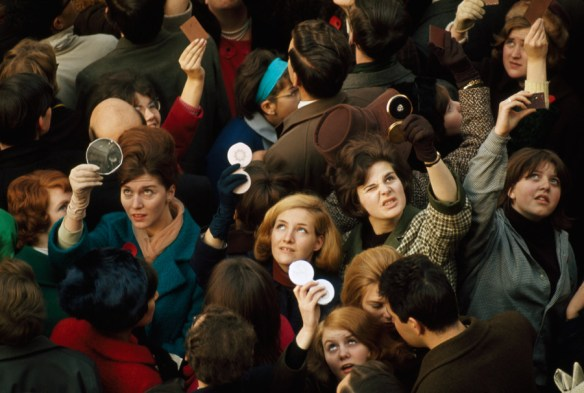 Women Use Compact Mirrors in 1966