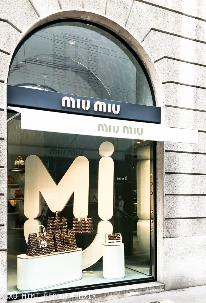 Bold and white at Miu Miu Milano