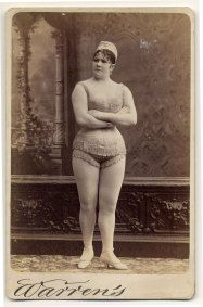 Viola Clifton facing front in a sleeveless, short, fringed top and short, fringed trunks. Image: Charles H. McCaghy Collection