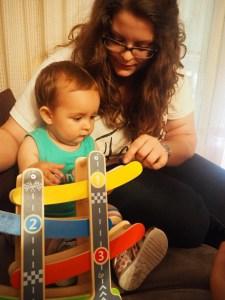 La tita jugando con la baby