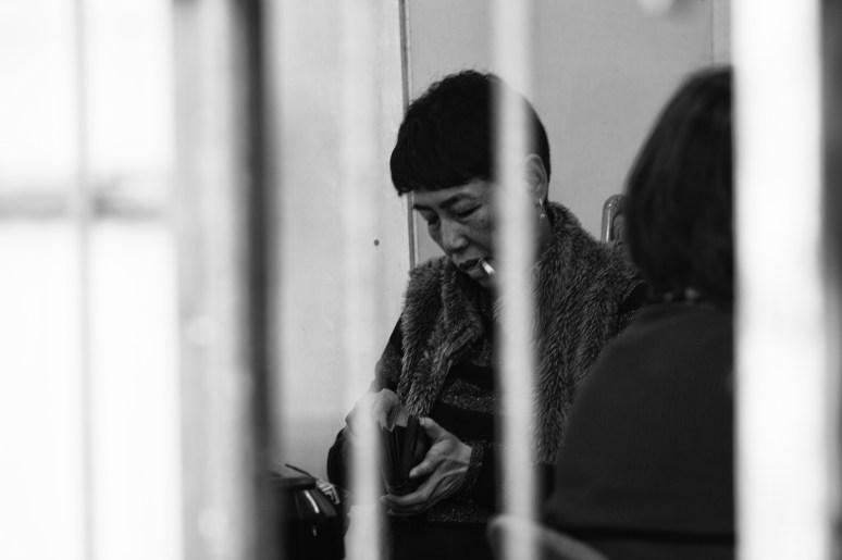 gambling women behind barred windows