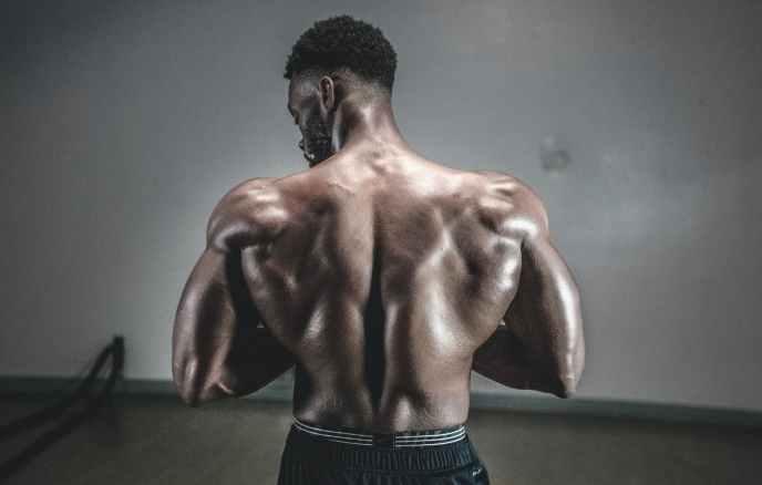 man flexing muscle