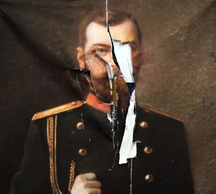 revolution-slashing-the-tsars-portrait-photograph-www-foxtrotfilms-com