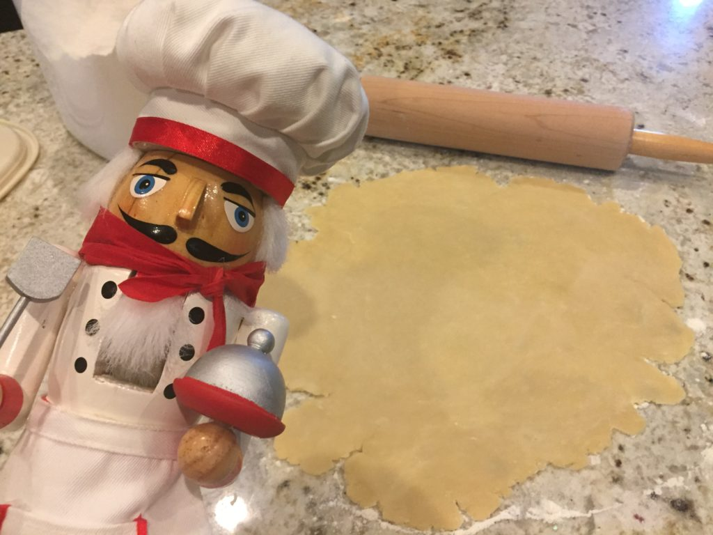 Pepe rolling out the pastry dough