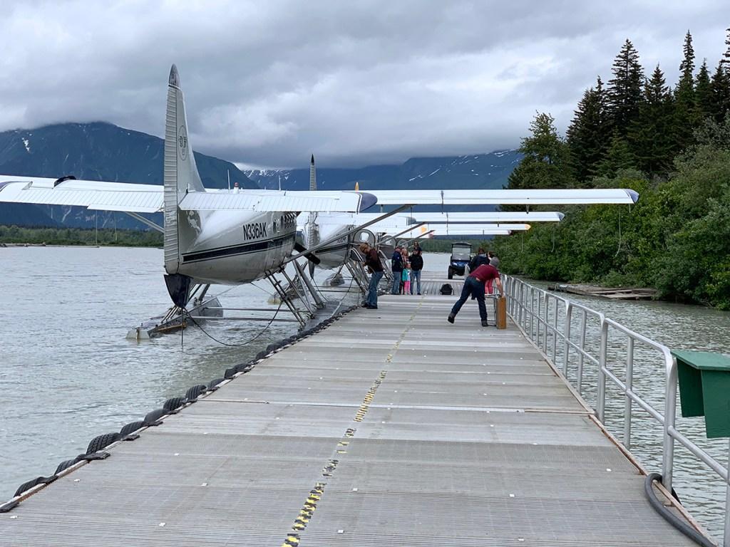 See planes docked at Taku Lodge in Juneau, Alaska