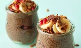 Two jars of overnight chocolate chia seed pudding topped with bananas, apples, and nuts