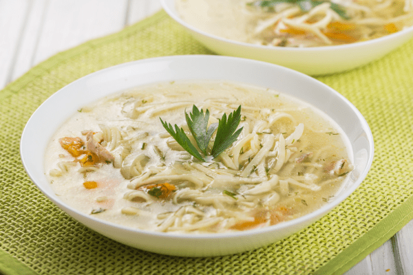 Delicious Chicken Zoodle Soup in a bowl, garnished with parsley