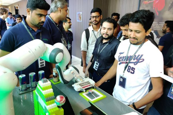 Visitors interacting with panda robot at Mindcurv's IoT showcase during the AWS Cochin event