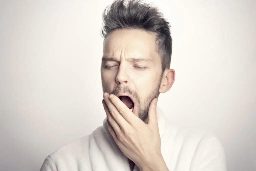 Can Meditation Replace Sleep? - man yawning