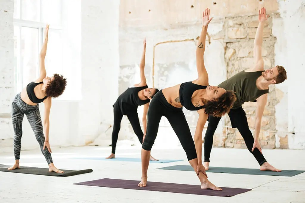 practicing types of yoga in a studio