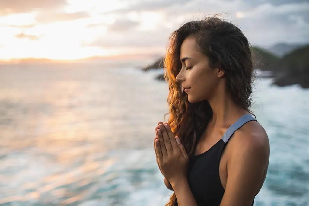 Women prays for Spiritual Awakening