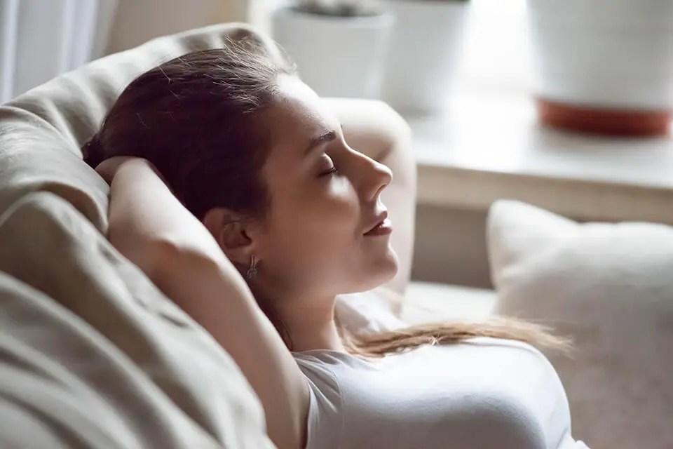 Women uses 4-7-8 breathing technique for sleep
