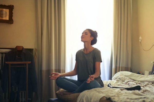 Can Meditation Replace Sleep? - meditating in bed