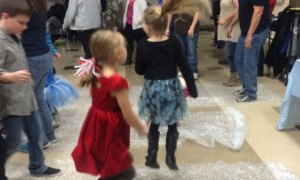 Two girls excitedly jumping on bubble wrap.