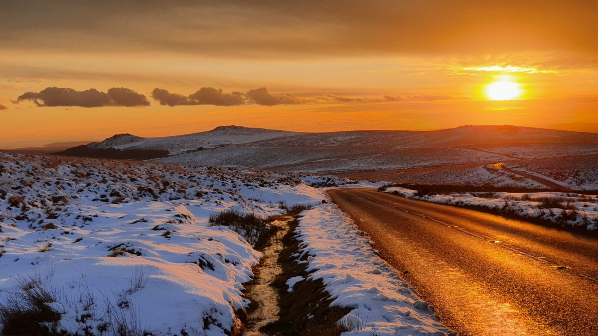 Sunset over snowy dartmoor, but spring is on its way