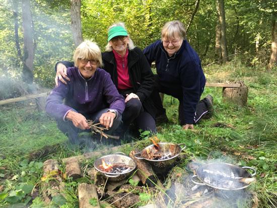 three women lighting fire