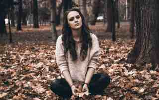 girl depressed in woods