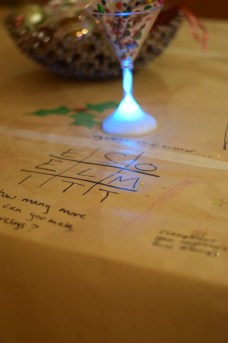 activities drawn on brown paper. Crayons are put in a light up martini glass!