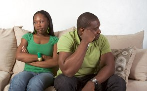 Unhappy couple sitting next to each other on couch | Discernment counseling | Marriage counseling | Couples therapy | Dallas TX 75287