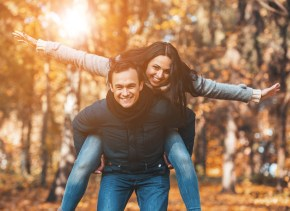Happy young couple in the Fall - Marriage Counseling for Affair Recovery available in Dallas, TX with a skilled couples therapist 75287