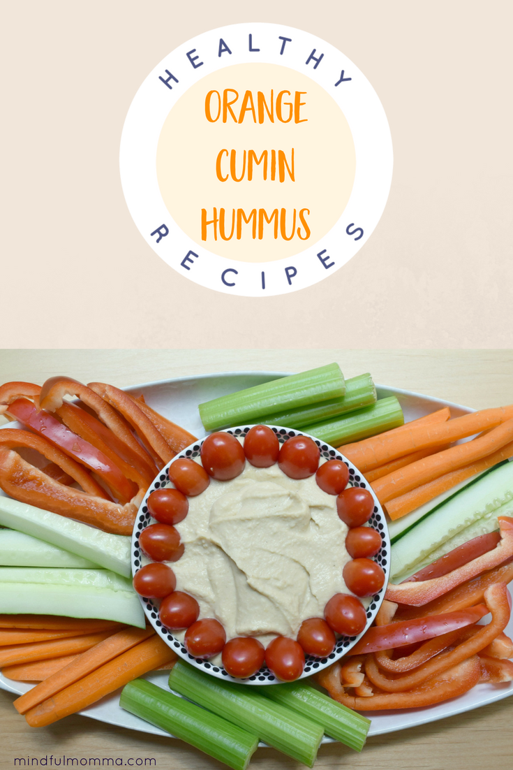 Everyone in the family will love this Orange Cumin Hummus dip. It is full of flavor - including orange juice, cumin spice and garlic - yet mild enough that even the kids will love it. | healthy snacks | #hummus #healthyrecipe #kidfood #dip  via @MindfulMomma