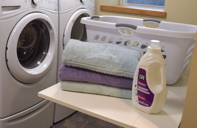 Eco Friendly Laundry Detergent and towels in laundry room