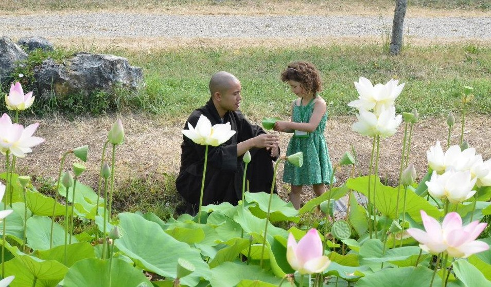 monk and child