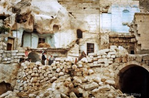 Girl and old lady talk by homes dug out of caves near Gorem, Cappadocia, Turkey, 1992