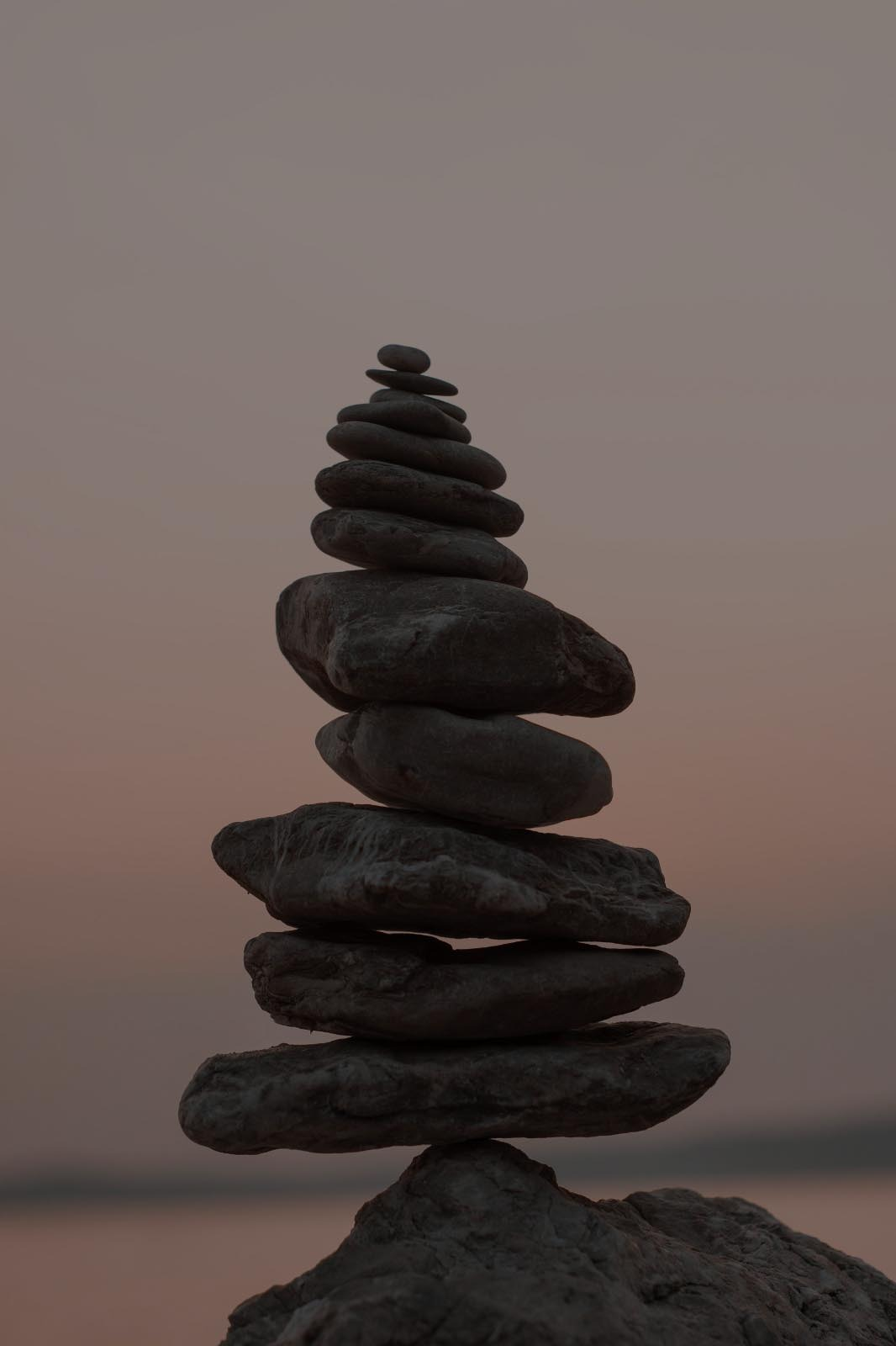 stones balancing on top of each other at sunset