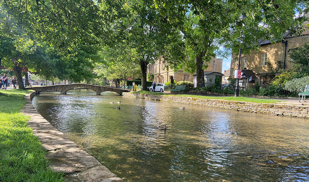 bourton on the water in the sun, looking out at the river windrush