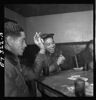 Tuskegee airmen playing cards in the officers' club in the evening March 1945