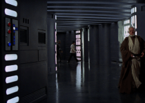 An ISB agent struts across a hall in the Death Star