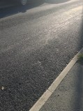 This is a picture of the newly finished road near my home - the sun was reflecting off it in a way that made it look 'glittery'.