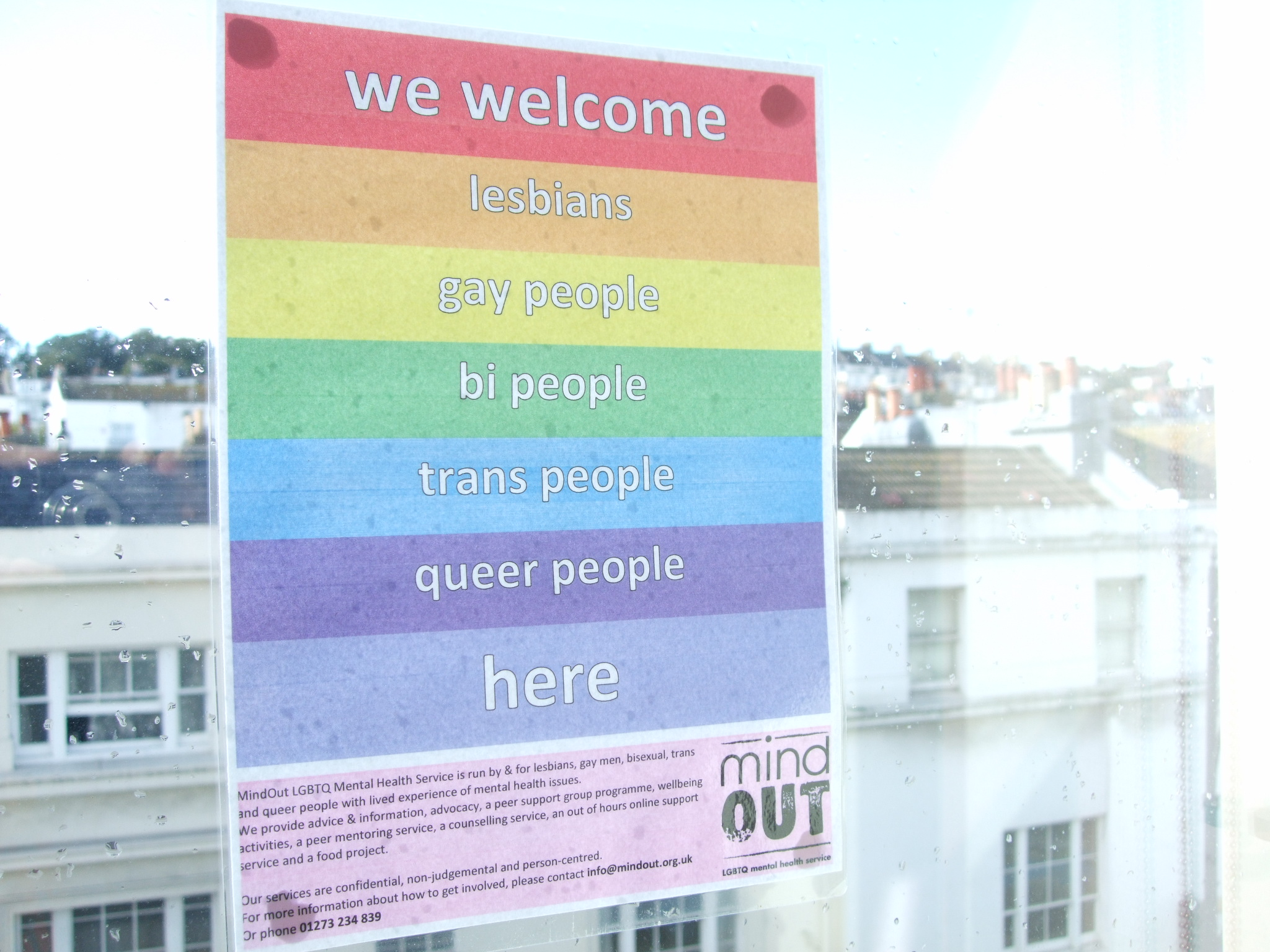 a poster welcoming LGBTQ people