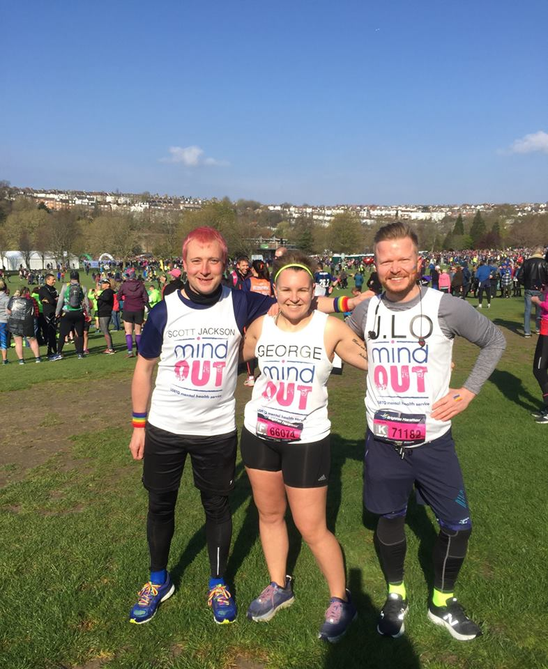 three runners standing proudly in their mindout branded marathon vests