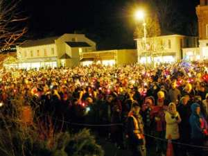 Listen to choirs at the Niagara on the Lake candle light walk