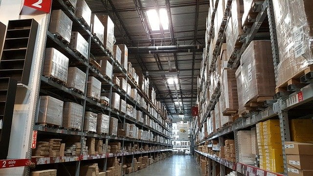 Boxes stacked on shelves in a storage unit