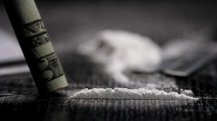 stock-footage-cocaine-snorted-off-a-table-close-up