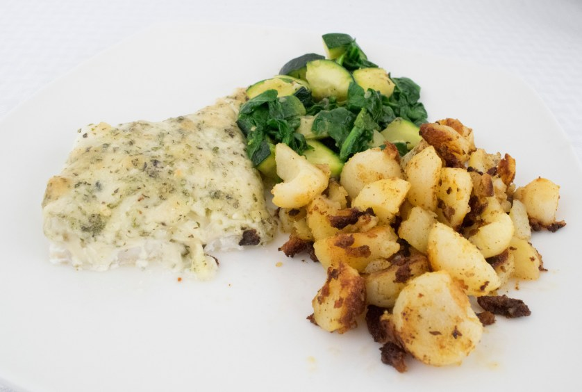 Cod with potatoes and zucchini and spinach