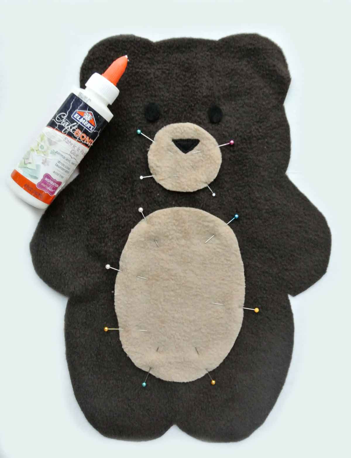 Bear Plush front fabric piece with craft bond and pins to keep accessory pattern (snout, belly) in place. How to Make Plushie Tutorial